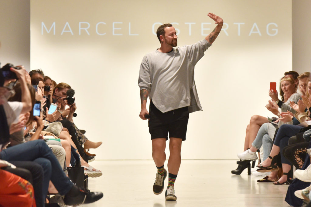 BERLIN, GERMANY - JULY 05: Designer Marcel Ostertag acknowledges the applause of the audience at the Marcel Ostertag show during the Mercedes-Benz Fashion Week Berlin Spring/Summer 2018 at Delight Studios on July 5, 2017 in Berlin, Germany. (Photo by Zacharie Scheurer/Getty Images for Marcel Ostertag) *** Local Caption *** Marcel Ostertag